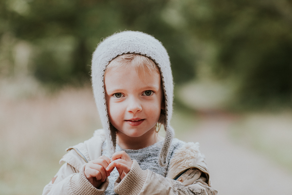 little girl portrait with pixie wooly hat on for family portrait session