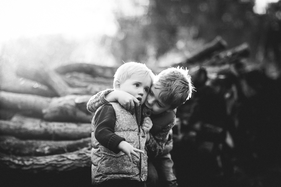 little boys hugging black and white portrait photo