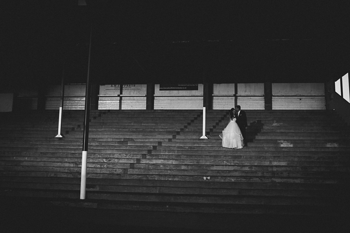 bride and groom in racecourse grandstand