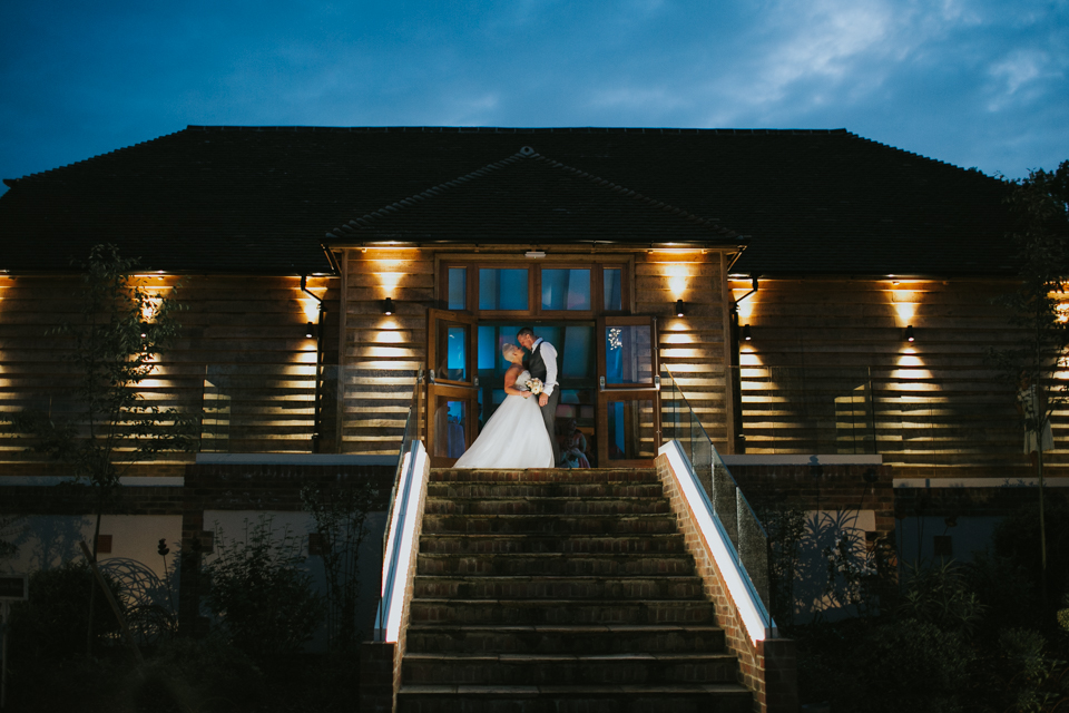wedding shoot couple on steps at Brookfield Barn Sussex